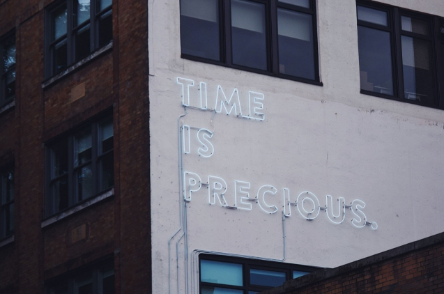 Lettering in wall: Time is precious