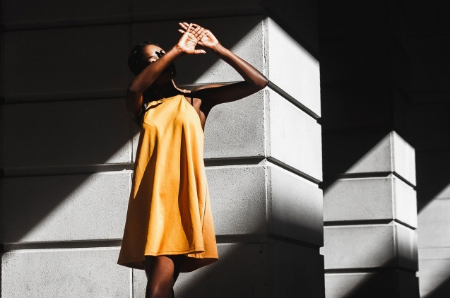Woman with yellow dress in the shadow