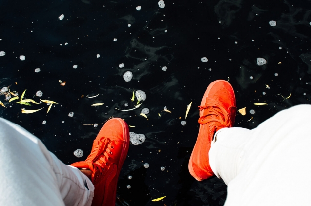legs hanging over a lake