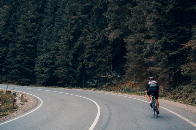 Cyclist in a lonely and natural road